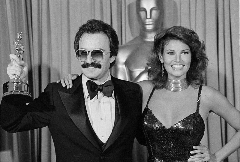 Giorgio Moroder holds his Oscar won for the best original score for Midnight Express at the 51 St. Oscar Awards ceremonies on Monday, April 10, 1979 in Los Angeles. Presenter is Actress Raquel Welch. (AP Photo)