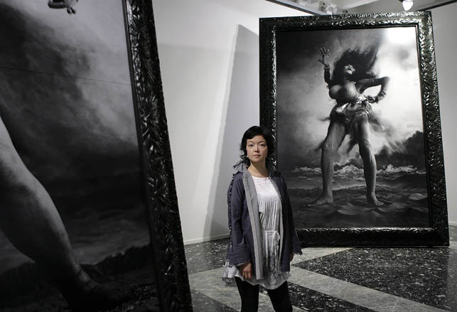 "Japanese artist Miwa Yanagi poses next to her ""Windswept Women"" at the Japanese pavilion during the vernissage of the 53rd Biennale International Art Exhibition in Venice, Italy, Thursday  June 4, 2009. (AP Photo/Alberto Pellaschiar)"