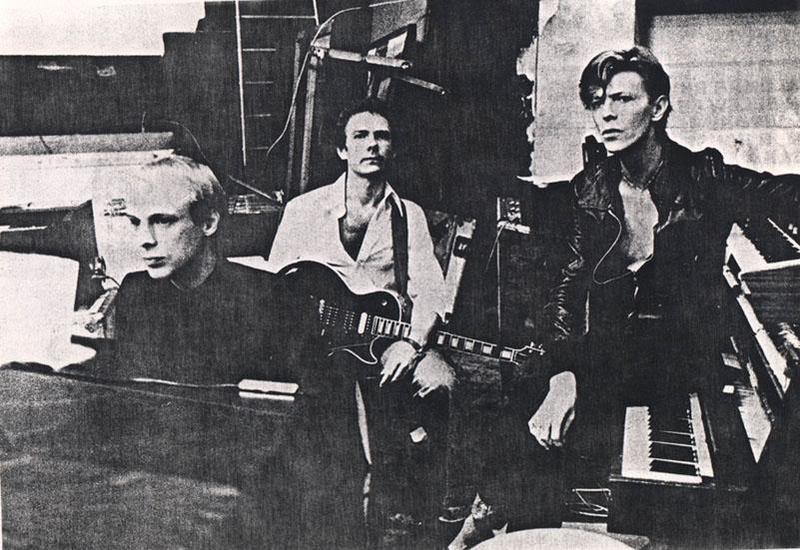 "Brian-Eno-Robert-Fripp-and-David-Bowie-Recording-""Heroes""-in-Berlin-1977"