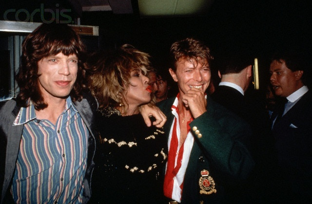 1986 --- Rock singers Mick Jagger of the Rolling Stones, Tina Turner, and David Bowie stand with their arms around each other's shoulders. --- Image by © Lynn Goldsmith/Corbis