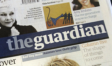 Britain's daily newspaper The Guardian, printed on new large tabloid format, is seen at a mini market in London, Monday Sept. 12, 2005. The new-look Guardian is now printed in the so-called Berliner format and is the latest step in the history of the paper spanning more than 180 years. (AP Photo/Lefteris Pitarakis)